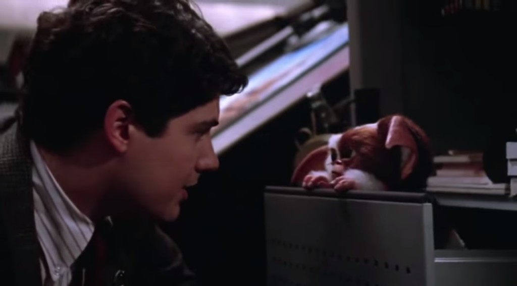 Billy (Zach Galligan) learns a valuable lesson in water conservation in Gremlins 2: The New Batch.