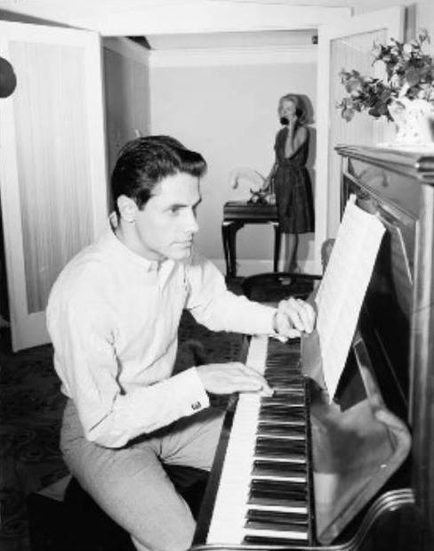 Ken at home and at the piano while wife, Marilyn, takes a call (Photographer: Laurie Richards. Susie Gamble private collection).